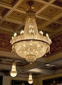 stock photo of flambeau  - Antique crystal chandelier - JPG