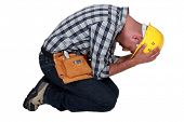 Construction worker on his knees