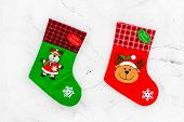 Christmas Socks. Traditional Decorative Socks For Small Gifts On White Stone Background Top View poster