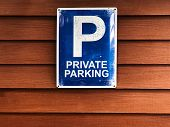Private Parking Sign On Wooden Wall. Blue Sign And White Color Text private Parking. Copy Space poster