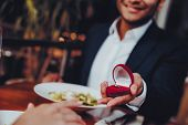 Close Up Handsome Man Proposing To Girlfriend. Romantic Couple In Love Dating. Cutel Man And Girl In poster