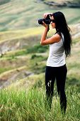 picture of megapixel  - Young brown haired woman photographing in Tuscany - JPG