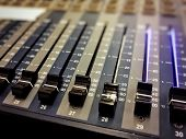 Professional Audio Mixer Console With Black Knobs To Equalize Sounds poster