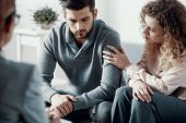 Supportive Beautiful Wife Touching Husbands Arm During Psychotherapy Session For Married Couples Wi poster