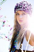 stock photo of beanie hat  - beautiful blond girl outdoors - JPG