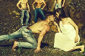 Four Handsome Young Macho Men With Muscular Sexy Body And Six Packs On Torso In Jeans And Pretty Wom poster