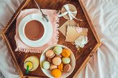 Breakfast In Bed With Empty Blank Card. Cup Of Coffee, Juice, Macaroons, Rose Flower And Giftbox On  poster