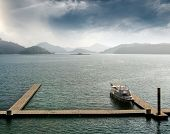 Boat with dock on water in famous landmark of Sun Moon Lake in Taiwan, Asia. poster