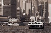 Famous landmark of Hong Kong ferry sailing on Victoria Harbor, Asia. poster
