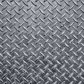 stock photo of rusty-spotted  - Background of metal diamond plate in silver color - JPG
