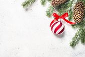 Christmas Flatlay Background With Fir Tree, Red Balls And Decorations On White  Background. Top View poster