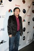 LOS ANGELES - DEC 7:  Masi Oka arrives at the JHRT's 9th Young Hollywood Holiday Party at Eden on De