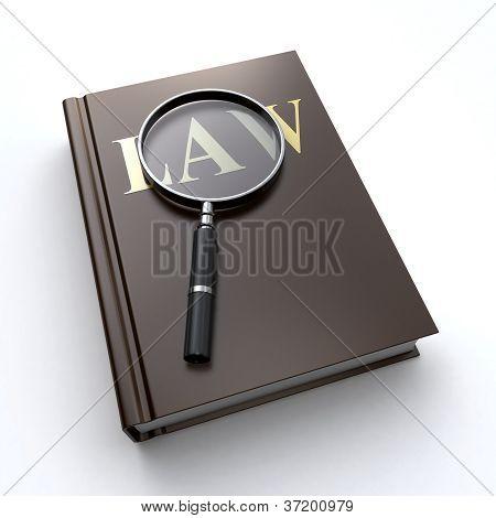 Livro de lei e uma lupa