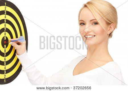 bright picture of businesswoman with dart and target....