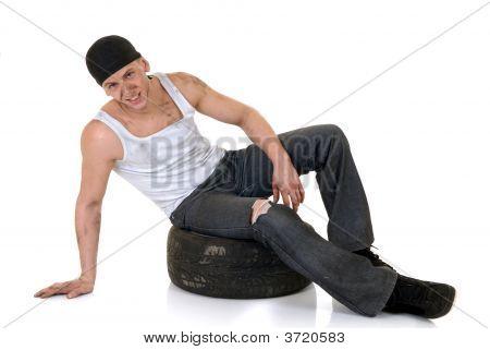 Car Repairman With Wheel
