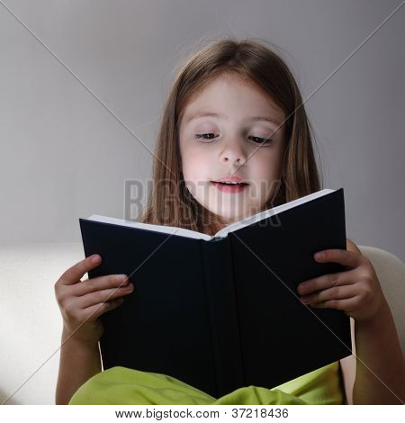 beauty girl read book on sofa