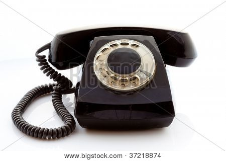 Retro rotary phone on a light background