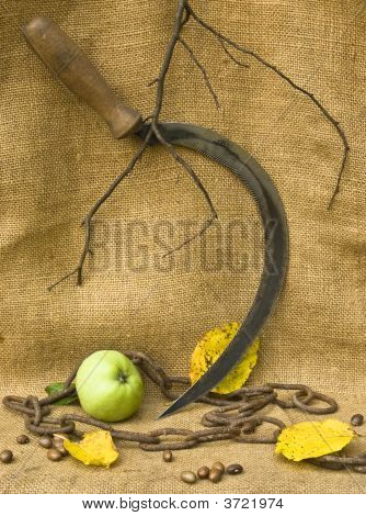 A Sickle With A Chain And An Apple