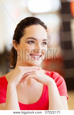 closeup of a happy young woman daydreaming