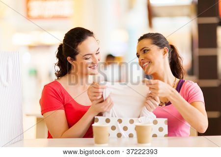 young women checking clothes that just bought