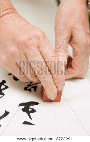 Hand Holding Agalmatolite Stamp