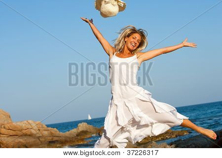 Happy Woman Jumping On Beach.