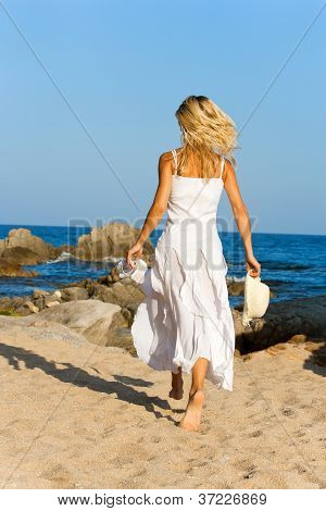 Young Woman In White Dress Running.