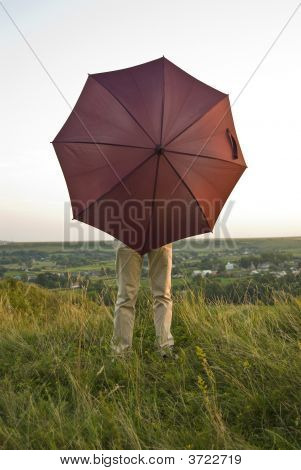 A Person Behind An Open Umbrella
