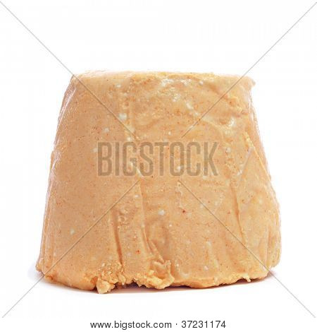 Afuegal Pitu cheese, from Asturias, Spain, on a white background
