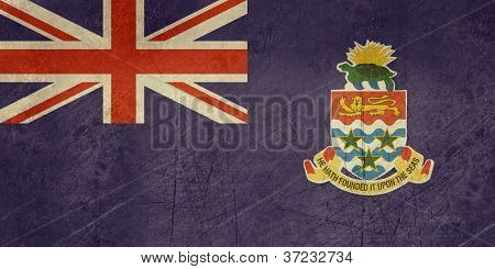Grunge Sovereign state flag of dependent country of Cayman Islands in official colors.