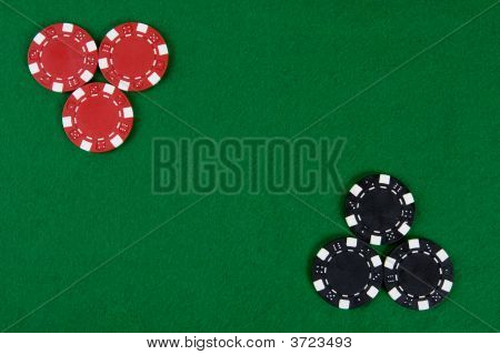 Poker Chips On A Green Table