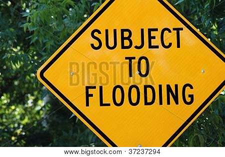 Yellow Road Sign: 'subject To Flooding'
