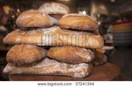 Fresh baked bread loaves stacked on counter