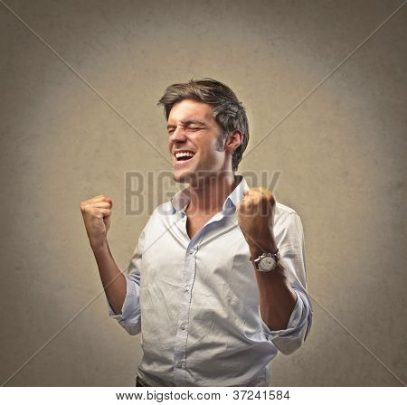 Man in white shirt exulting on a beige background