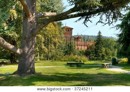 Medieval Castle among trees at botanical garden located at Valentino Park (Parco del Valentino) in Turin, Northern Italy.
