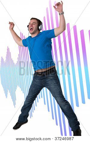 Young Man Listening To Music And Jumping
