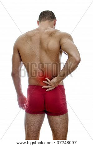 Rear View Of Muscular Man With Spinal Pain. Isolated On White.