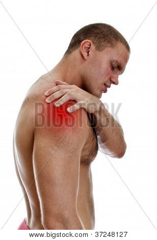 Young Man Suffering From Pain In His Shoulder. Isolated On White.