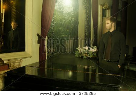 Young Man Looking In Mirror