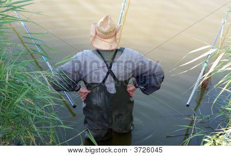 Fisherman Standing Akimbo Before Three Rods, Rear View