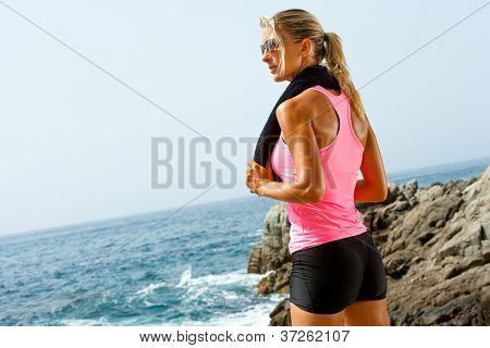 Young Fitness Woman At Seaside With Towel.