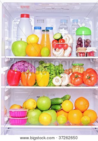 Shot of an open fridge with healthy food products