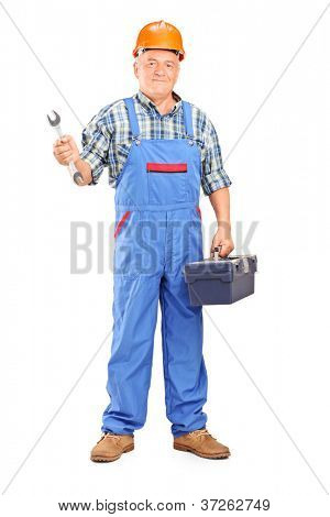 Full length portrait of a manual worker holding a wrench and tool box isolated against white background