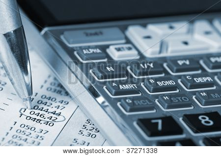 Calculator and a financial document. Accountant.