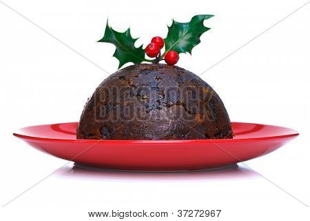 Christmas pudding with holly on top against a white background.
