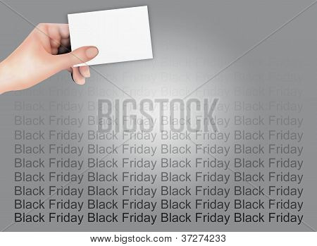 Hand Holding A Blank Card on Black Friday Background