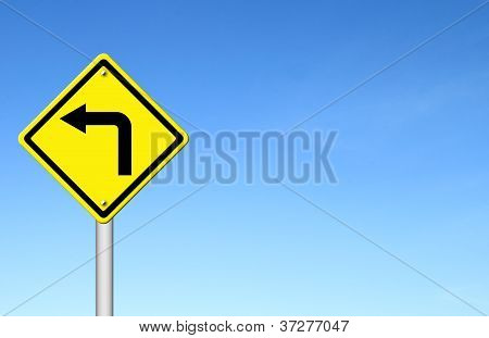 Road Sign - Left Turn Warning With Blue Sky