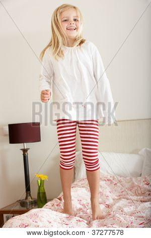 Young Girl Bouncing On Bed