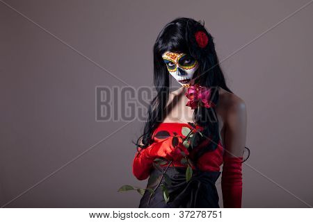 Sugar skull girl holding red rose, Day of the Dead Halloween theme