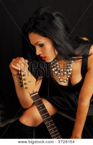 Hispanic Female Rocker With Guitar